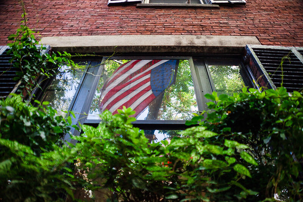 American flag reflection in Acorn Street, Boston