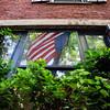 American flag reflection in Acorn Street, Boston