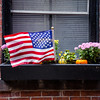 American flag in a street of Boston