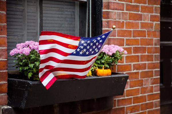 American flag in a street of Boston