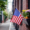 American flag in a street of Boston's historic neighborhood, Beacon Hill