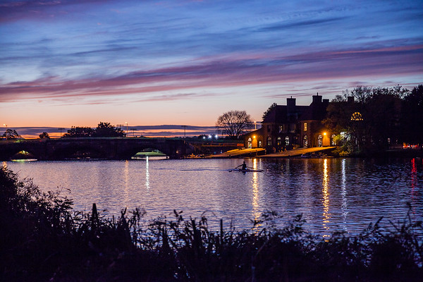 Sunset over Weld Boathouse and the Charles River