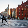 Skateboarding on the harborwalk during sunset in Boston