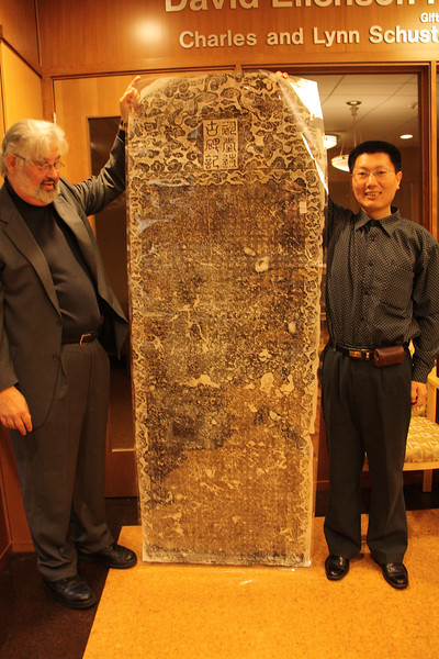Dr. Gilner and Shi Lei with a rubbing from stele from Kaifeng