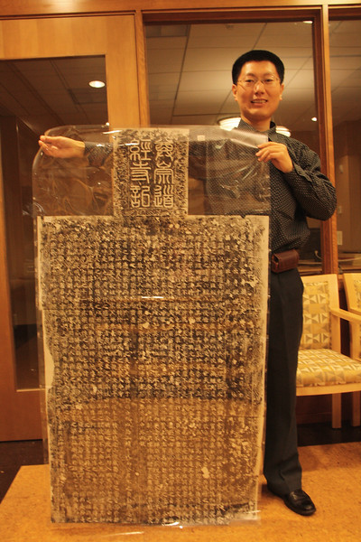 Shi Lei with Rubbing from stele from Kaifeng