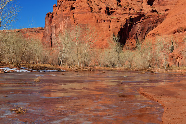 Vivid Red rock reflecting in stream