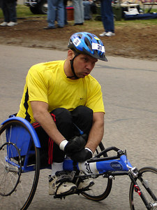 One of the wheelchair racers in the Boston Marathon - Chestnut Hill, MA - April 17, 2006 ... Photo by Rob Page III