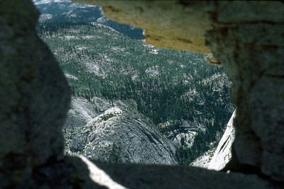 Ref: 0307M01 ... July 16 2003 ... Yosemite National Park California - Rich Dunhoff Memorial Trip - Half Dome Descent - Base of Half Dome dome - view to west through rocks. ... Photographed by Robert W Page Jr