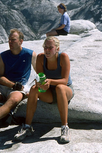 Ref: 0307L06 ... July 16 2003 ... Yosemite National Park California - Rich Dunhoff Memorial Trip - Hike up Half Dome from Little Yosemite Valley - At base of dome below cables - Heather Page looking at cable. ... Photographed by Robert W Page Jr