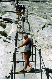 Ref: 0307L11 ... July 16 2003 ... Yosemite National Park California - Rich Dunhoff Memorial Trip - Hike up Half Dome from Little Yosemite Valley - Hiking up dome on cable - Heather Page (and Rob Page III just above her). ... Photographed by Robert W Page Jr