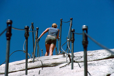 Ref: 0307L13 ... July 16 2003 ... Yosemite National Park California - Rich Dunhoff Memorial Trip - Hike up Half Dome from Little Yosemite Valley - Hiking up dome on cable - Heather Page near top of cable. ... Photographed by Robert W Page Jr