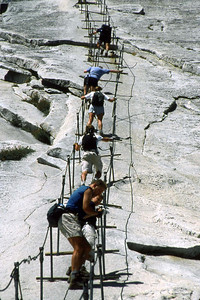 Ref: 0307L10 ... July 16 2003 ... Yosemite National Park California - Rich Dunhoff Memorial Trip - Hike up Half Dome from Little Yosemite Valley - Hiking up dome on cable - Rob Page III (#3), Joyce Page (#5). ... Photographed by Robert W Page Jr