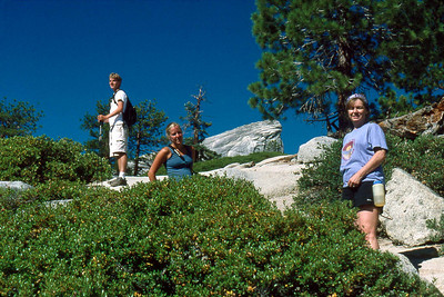 Ref: 0307K35 ... July 16 2003 ... Yosemite National Park California - Rich Dunhoff Memorial Trip - Hike up Half Dome from Little Yosemite Valley - Nearing base of dome - Rob Page III, Heather page, Joyce Page. ... Photographed by Robert W Page Jr