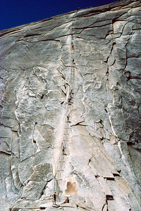 Ref: 0307L33 ... July 16 2003 ... Yosemite National Park California - Rich Dunhoff Memorial Trip - Descending Half Dome cable- Rob Page III standing at bottom, Heather Page sitting at bottom, Joyce Page approaching bottom. ... Photographed by Robert W Page Jr