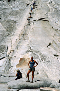 Ref: 0307L09 ... July 16 2003 ... Yosemite National Park California - Rich Dunhoff Memorial Trip - Hike up Half Dome from Little Yosemite Valley - Heather Page at bottom of cable - Rob Page III (#1) and Joyce Page (#3) hiking up dome on cable. ... Photographed by Robert W Page Jr