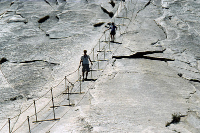 Ref: 0307L34 ... July 16 2003 ... Yosemite National Park California - Rich Dunhoff Memorial Trip - Descending Half Dome cable- Rob Page III (bottom) and Joyce Page approaching bottom of cable. ... Photographed by Robert W Page Jr