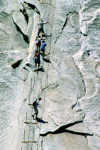 Ref: 0307L32 ... July 16 2003 ... Yosemite National Park California - Rich Dunhoff Memorial Trip - Descending Half Dome cable- Rob Page III is at bottom - Joyce Page is sideways ... Photographed by Robert W Page Jr