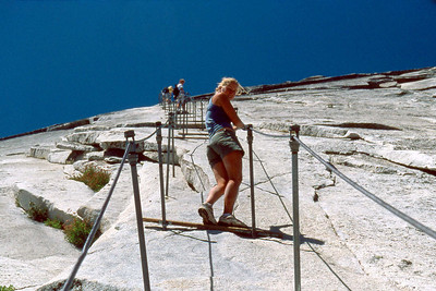 Ref: 0307L29 ... July 16 2003 ... Yosemite National Park California - Rich Dunhoff Memorial Trip - Descending Half Dome - Heather Page on cable. ... Photographed by Robert W Page Jr