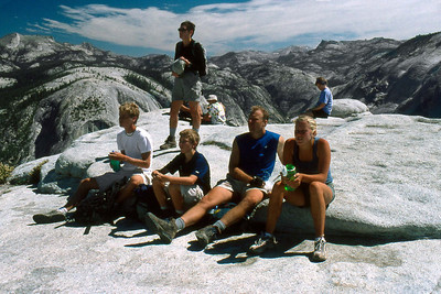 Ref: 0307L07 ... July 16 2003 ... Yosemite National Park California - Rich Dunhoff Memorial Trip - Hike up Half Dome from Little Yosemite Valley - At base of dome below cables - Heather Page looking at cable (Joyce Page - sitting behind Heather on right. ... Photographed by Robert W Page Jr