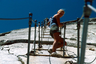Ref: 0307L28 ... July 16 2003 ... Yosemite National Park California - Rich Dunhoff Memorial Trip - Descending Half Dome - Heather Page on cable. ... Photographed by Robert W Page Jr
