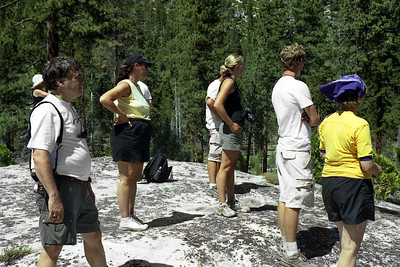 Ref:  0307Z02  July 15 2003  Yosemite National Park California - Rich Dunhoff Memorial Trip.  Little Yosemite Valley.  Admiring the view from the site where we spread Rick's ashes.  Left to right:  Carol Hubbard (white hat), Bob Page Jr, Tess Dunhoff, Stu Hubbard (behind Tess), Nate Dunhoff, Heather Page, Rob Page III, Joyce Page.  Photographed and owned by Karen Page