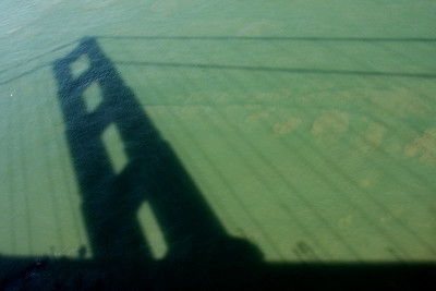 The shadow of the Golden Gate Bridge in the bay below - San Francisco, CA ... March 12, 2009 ... Photo by Rob Page III