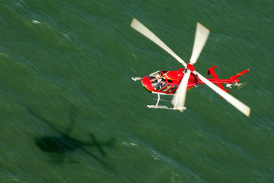A helicopter flies below the Golden Gate Bridge - San Francisco, CA ... March 12, 2009 ... Photo by Rob Page III