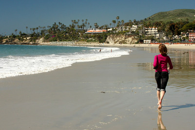 Emily running along the beach to watch the dolphins - Laguna Beach, CA ... March 7, 2009 ... Photo by Rob Page III