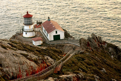 Point Reyes Lighthouse was built in 1870.  It is located near water level to be seen below the fog banks that roll in at this windy point - Point Reyes National Seashore, CA ... March 12, 2009 ... Photo by Rob Page III
