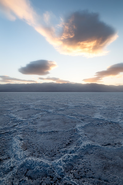 Death Valley, Badwater - Large hexagonal tiles after sunset with similar cloud