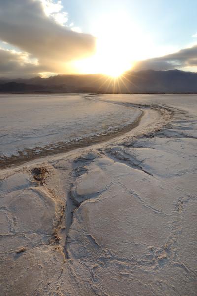 Death Valley, Badwater - Salt river in salt flat at sunrise