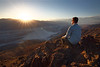 Death Valley, Dante's View - Man sitting on rock watching sunset over Badwater