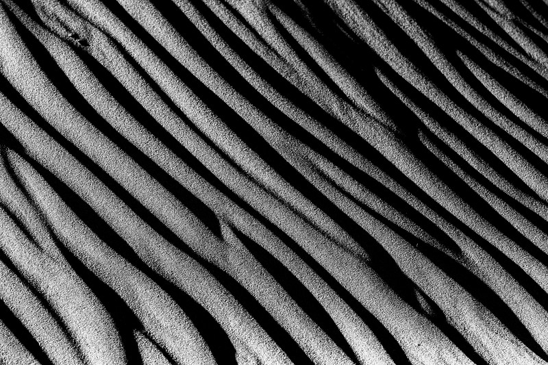 Death Valley, Mesquite Flat - Black and white sand dune texture close up, horizontal