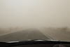 Death Valley, Stovepipe - In-car shot of road approaching town in sand storm