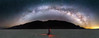Death Valley, Badwater - Lone photographer under the arch of the Milky Way, panorama