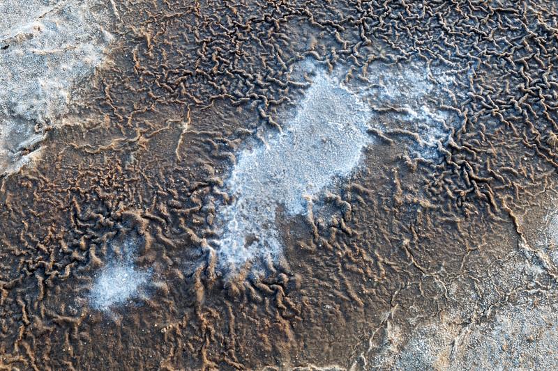 Death Valley, Patterns - White salt island with brown ridges around it, above