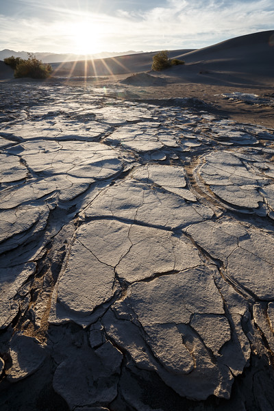 Death Valley, Mesquite Flat - Close up of mud playa in dunes with sunstar