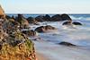 Misty rocks on shoreline in Malibu