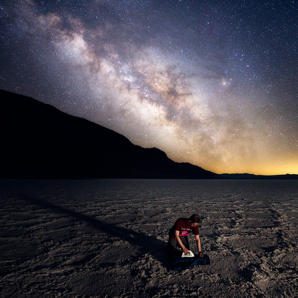 Death Valley, Badwater - Man ironing on basin under Milky Way, world record