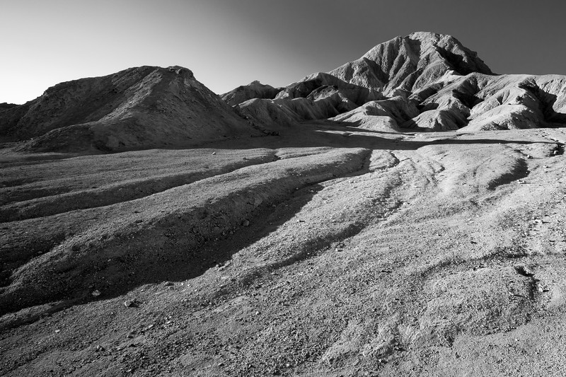 Death Valley, 20 Mule - Eroded badlands wide view in black and white