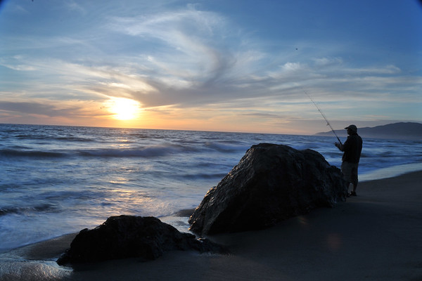 Sunset in Malibu with fisherman