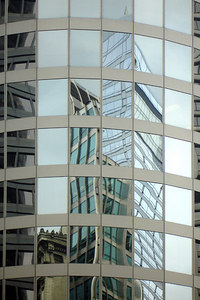 The different types of buildings reflect in the glass of a modern skyscraper - Chicago, IL ... September 22, 2006 ... Photo by Rob Page III
