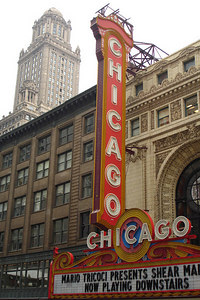The Chicago Theatre.  Designed in the classical revival-French Baroque style by architects Cornelius W. Rapp and George L. Rapp, the building was built in 1921, at a cost of $4 million dollars, at 175 North State Street.  It opened on October 21, 1921.  35 East Wacker Drive rises in the background - Chicago, IL ... September 22, 2006 ... Photo by Rob Page III