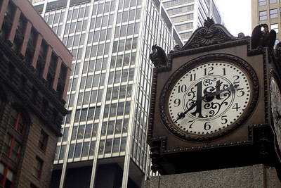 This is the First National Bank Clock surrounded by the buildings of Chicago - Chicago, IL ... September 22, 2006 ... Photo by Rob Page III