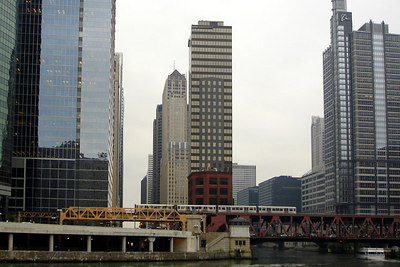 "Looking down towards the south branch of the Chicago River,  On the left is the modern glassy building of 191 North Wacker.  On the other side of the river is 100 N. Riverside Plaza (aka Boeing).  In the foregorund you can see one of the ""El"" trains making its way into the city - Chicago, IL ... September 22, 2006 ... Photo by Rob Page III"