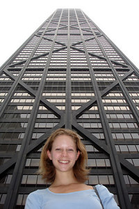 Emily and the John Hancock Center.  This is one of the most iconic buildings of Chicago and the world.  Completed in 1969, It rises 1,127 feet with 100 floors - Chicago, IL ... September 23, 2006 ... Photo by Rob Page III
