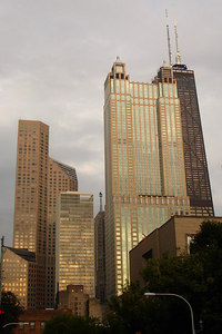 The John Hancock Building rises behind some of the other buildings of the city at sunset - Chicago, IL ... September 23, 2006 ... Photo by Rob Page III