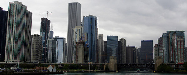 "The Chicago skyline at the mouth of the Chicago River.  The tall building is the Aon Center constructed in 1973 and rises 1,136 feet.  Originally it was owned by Standard Oil and was called ""Big Stan"" - Chicago, IL ... September 23, 2006 ... Photo by Rob Page III"