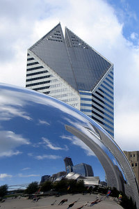 The 582 foot Smurfit-Stone Building rises behind the Cloud Gate - Chicago, IL ... September 24, 2006 ... Photo by Rob Page III