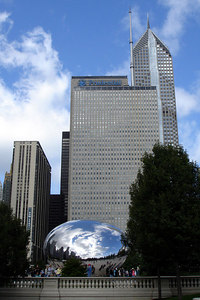 The Cloud Gate looks like a ball of mercury with the Prudential complex rising behind it - Chicago, IL ... September 24, 2006 ... Photo by Rob Page III